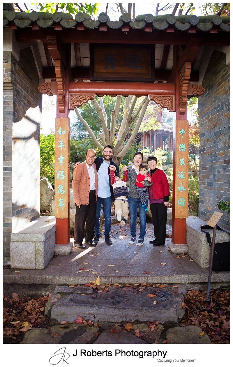 Family portrait photography Sydney at the Chinese Gardens of Friendship Darling Harbour for 60th birthday present